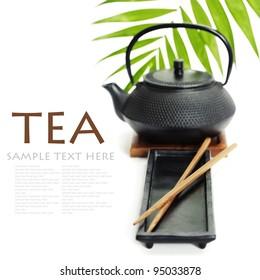 Asian food concept (Tea pot and chopsticks) with sample text