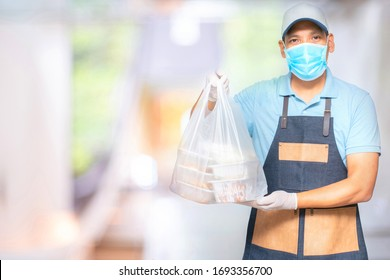 Asian food delivery man wear mask and gloves for cleanliness and hygiene,protect for pandemic and outbreak covid-19 or corona virus, use delivery service in social distancing  and quarantine.