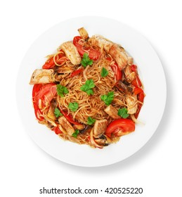 Asian food. Fried Thai glass Rice noodles with meat and vegetables. Chinese glass rice vermicelli fried with meat and tomatoes. Korean funchoza cellophane noodles. Top view, flat lay, isolated.