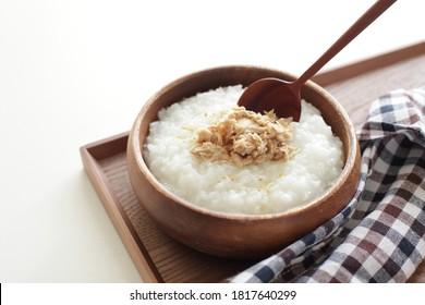 Asian food, Korean style tuna and sesame oil on rice porridge in wooden bowl