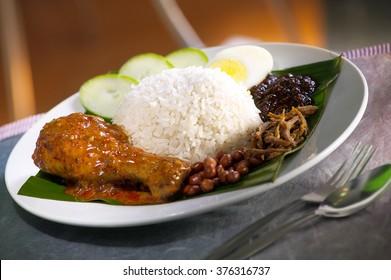Asian food nasi lemak with chicken rendang
