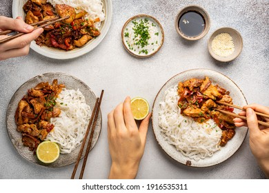 Asian food rice noodle served with chicken in Teriyaki sauce and sesame seeds, top view