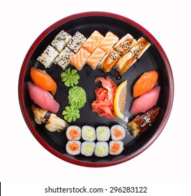Asian food sushi set on wooden plate isolated on white background