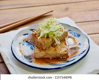 Asian food Tofu simmered in soy sauce, Dubu-jorim, Stewed tofu, BraisedTofu