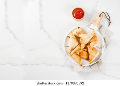 Asian food. Vegetarian samsa (samosas) with tomato sauce. white marble background copy space top view