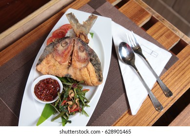 asian fried milk fish on the restaurant table