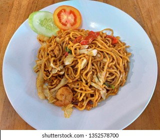 Asian fried noodles, also known as mie goreng or mee goreng, a popular local dish in Southeast Asia.