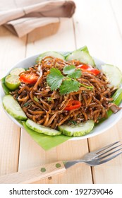 Asian fried noodles, ready to serve on dining table.