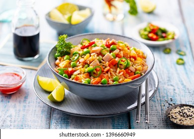 Asian fried rice. Blue wooden background. Close up.