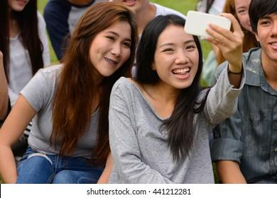 Asian friends park selfie