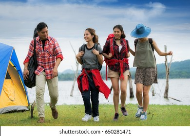 Asian friends walking in camping and nature background, backpack, travel and adventurous concept