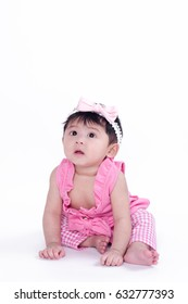 Asian girl 6 months old on a white background