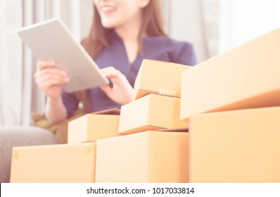 Asian Girl is addited to online shopping, full of deliveried boxes