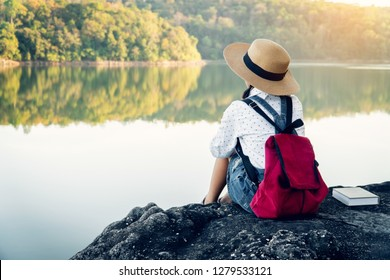 Asian girl backpack on the park background, journey and traveling on holiday concept .