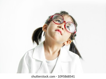 asian girl with big glass and science suite action on white screen. looking up Action kid model with doctor or science costume.