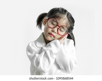 asian girl with big glass and science suite action on white screen. sleep or dreaming action kid model with doctor or science costume.