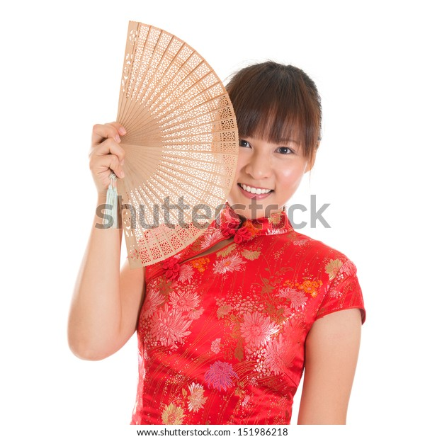 Asian girl with Chinese traditional dress cheongsam or qipao holding Chinese fan. Chinese new year concept, female model isolated on white background.