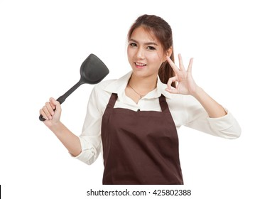Asian girl cook show OK with spade of frying pan  isolated on white background