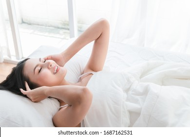 Asian girl cute and beautiful Wake up in a good mood Smile happily