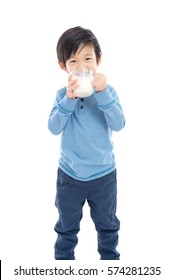 Asian Girl drinking milk from a glass on white background isolated