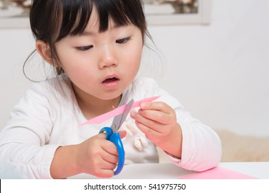 asian girl enjoys craft work