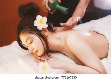 Asian girl feeling relax with hand massage in spa salon