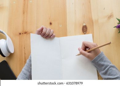 asian girl female teenager studying at school. Student writing note on wood desk - education, people and learning concept