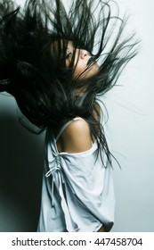 asian girl with hair lightly fluttering in the wind