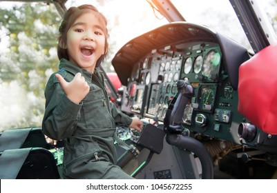 asian girl hanging helicopter control dream job to be a pilot