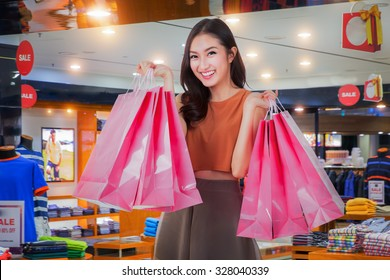 Asian girl happy enjoy shopping in department store