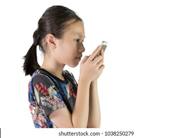 Asian girl have eye problems,Nearsighted concept,Visually impaired,Girl is using a mobile smart phone isolated on white background
