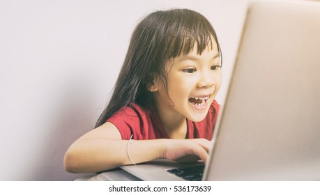 Asian girl is having fun surfing the internet.