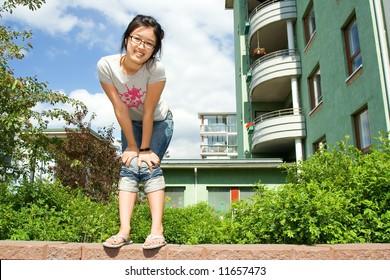 Asian girl having fun in the yard