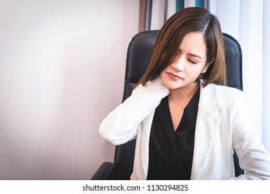 Asian Girl having Neck pain from office syndrome