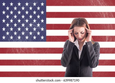 Asian girl with headache over USA flag background.Stressful girl with learning English