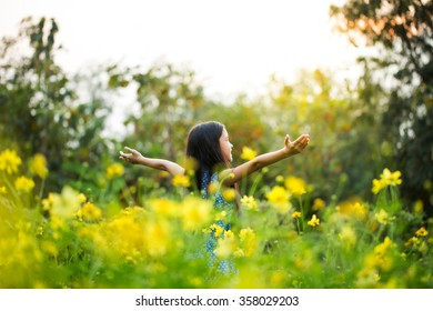 Asian girl with healthy long hair having fun in the meadow, Freedom concept