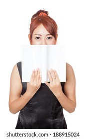 Asian girl hide her mouth with a book