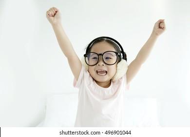 Asian girl, hipster little girl screaming, Happy little girl, excited little girl hold hands up, stick them up!