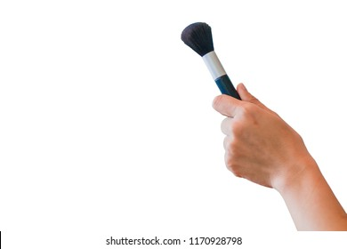 An Asian girl holding a cheeks brush for make-up with black bristles in her hands on a white background. Girl holding a cheeks brush in hand to use in makeup.( clipping path )