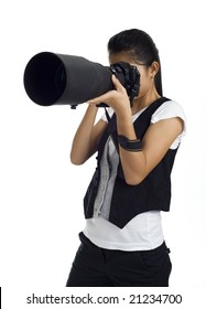 asian girl holding a dslr cam with an 300mm tele lens attached