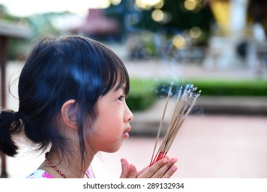 Asian girl holding incense pay respect