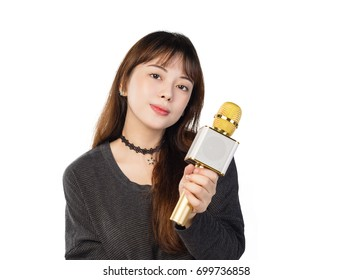 Asian girl holding a wireless microphone