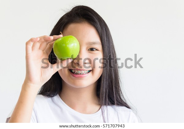 Asian girl with apple