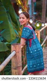 asian girl in holiday by posing smile relaxation in nature mountain and watercourse by wearing lanna dress north thailand