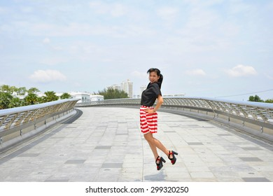 asian girl jump on the bridge