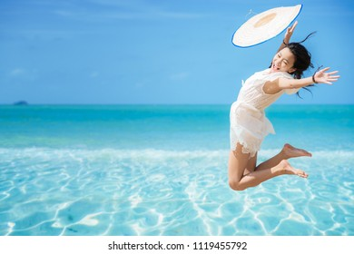 asian girl jumping freedom from the boat to the sea, this immage can use for fun, summer, beach, play, happy, woman and holiday concept