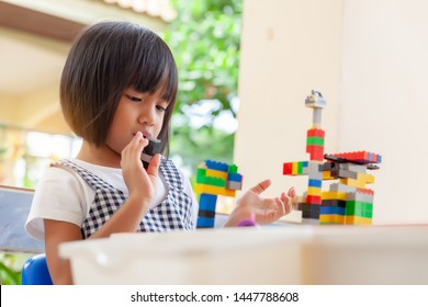 Asian girl kid play lego or toy, Asian girls relax with playing blocks, Asian girls enjoy playing toys.