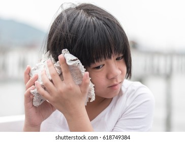 Asian girl kid relaxing with peaceful mind on the beach during  spring break or summer holiday vacation concept