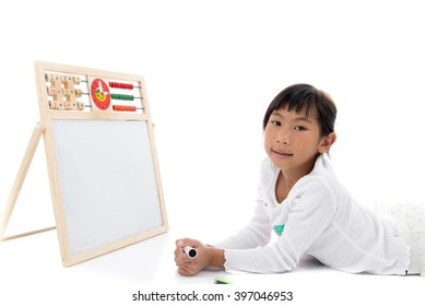 Asian girl laying with blank whiteboard on white background.