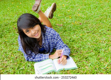 Asian girl left handed study in the park